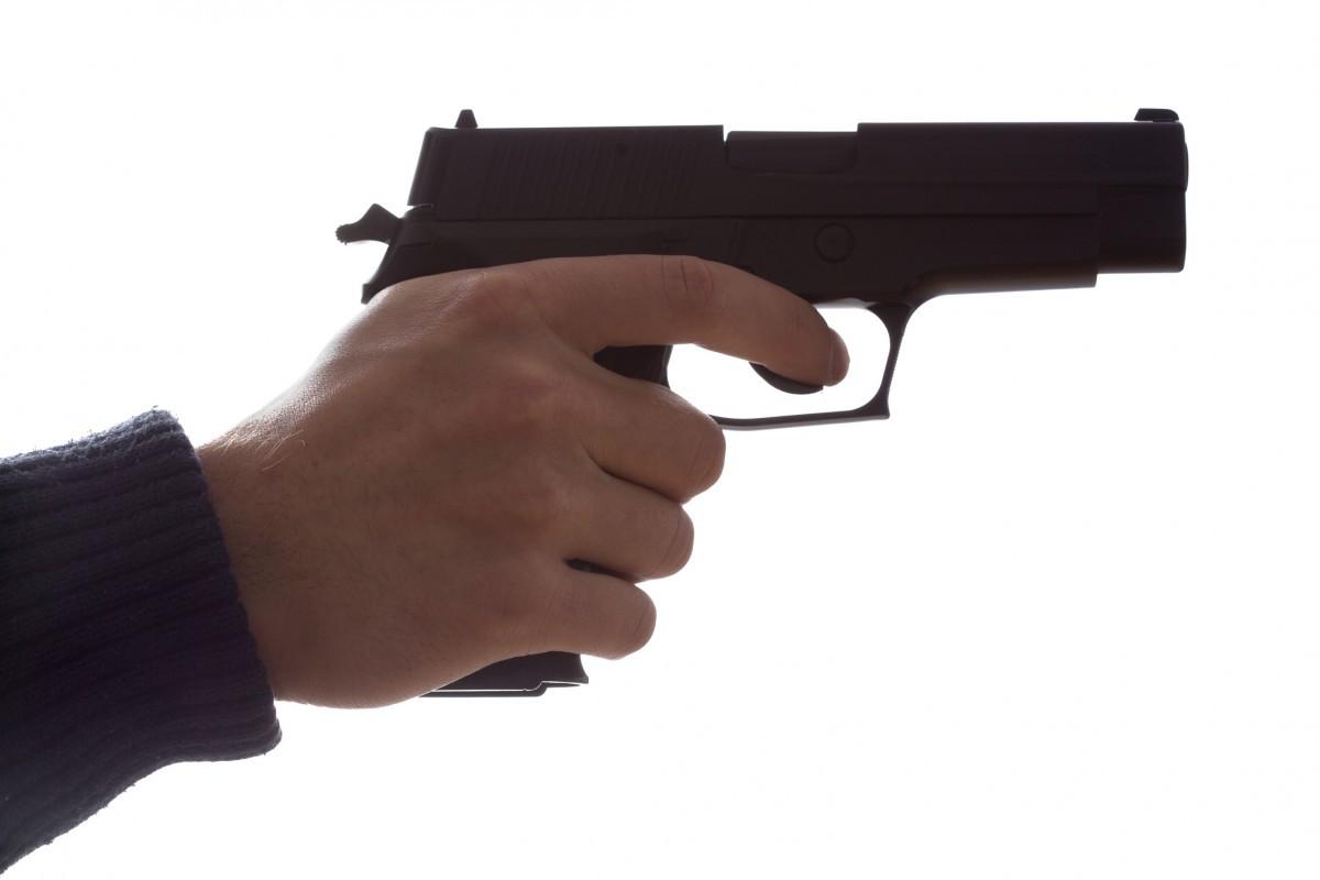 Hand-Holding-Gun-459074939
